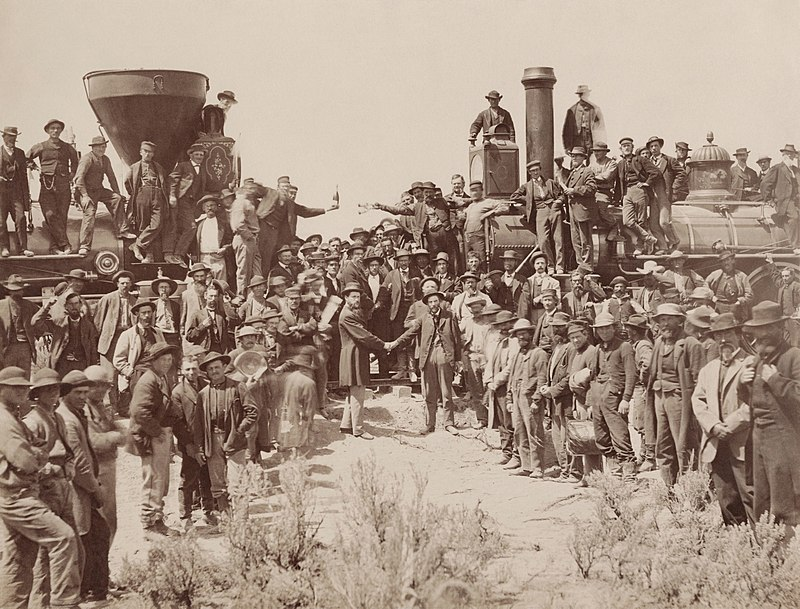 800px-East_and_West_Shaking_hands_at_the_laying_of_last_rail_Union_Pacific_Railroad_-_Restoration (1)